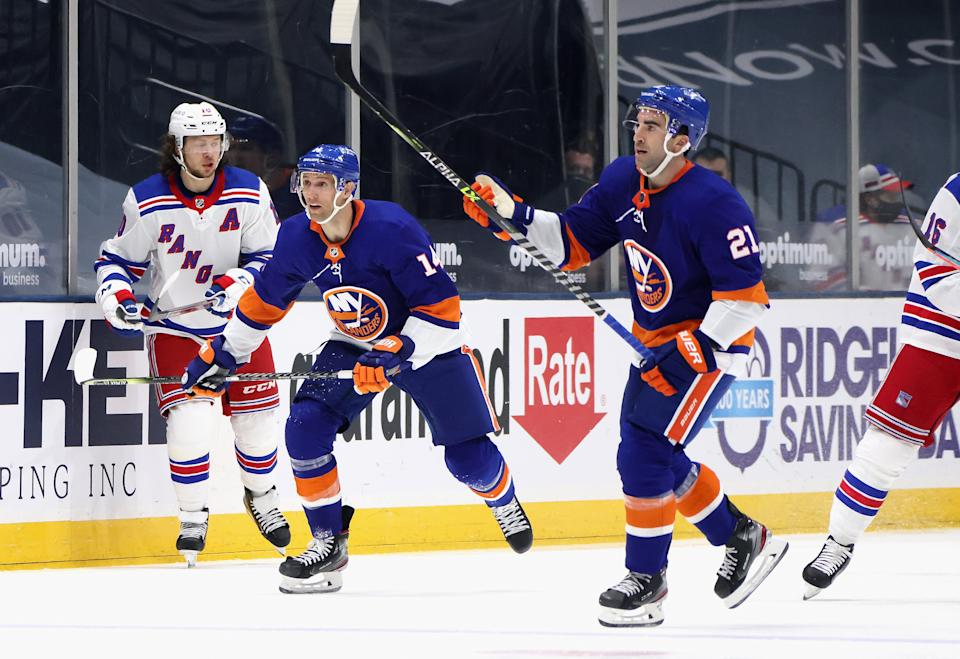 UNIONDALE, NEW YORK - APRIL 09: Kyle Palmieri #21 and Travis Zajac #14 of the New York Islanders skates against the New York Rangers at Nassau Coliseum on April 09, 2021 in Uniondale, New York. (Photo by Bruce Bennett/Getty Images)