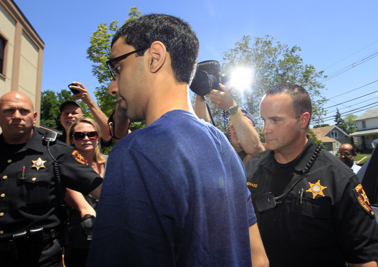 Dharun Ravi, 22, is photographed by the media as he arrives at the Middlesex County sheriff's department in New Brunswick, N.J., Thursday, May 31, 2012. The former Rutgers University student convicted of using a webcam to spy on his gay roommate reported to the sheriff on his way to jail. Ravi arrived at the sheriff's department shortly after 12:30 p.m. to be fingerprinted and photographed before being driven to the county jail to serve a 30-day term. (AP Photo/Mel Evans)