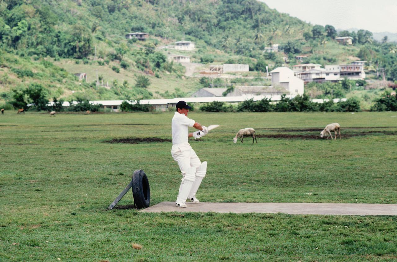 ST VINCENT - JANUARY 1981:  Geoff Boycott of England practices his batting in a unusual setting during a training session for England's tour of the West Indies held in January 1981 on the St Vincent Islands. (Photo by Adrian Murrell/Getty Images)