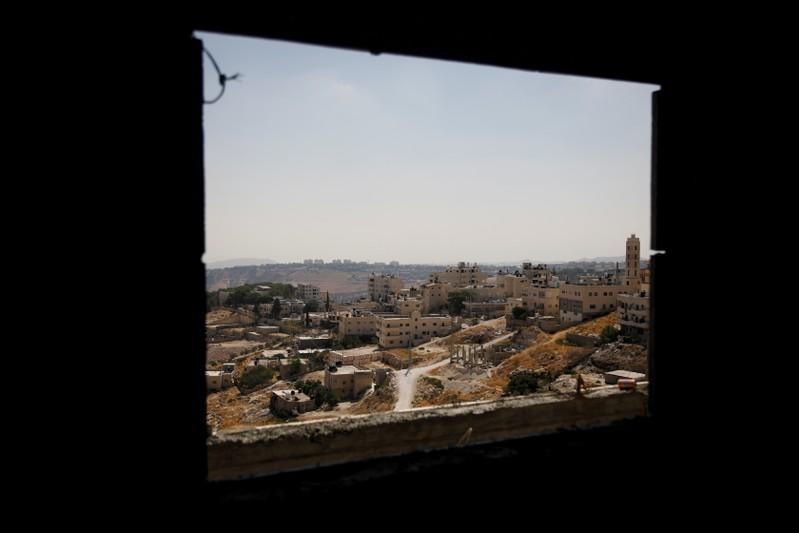 FILE PHOTO: A view shows Palestinian houses in al-Eizariya village, close to the Jewish settlement of Maale Adumim, in the Israeli-occupied West Bank