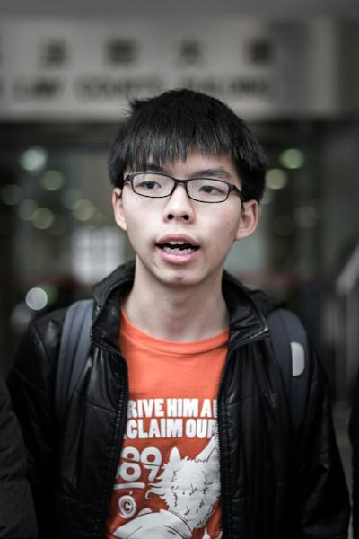 """Joshua Wong has been in and out of court hearings after being charged with multiple offences linked to the mass protests in Hong Kong, leading up to what became known as the """"Umbrella Movement"""""""