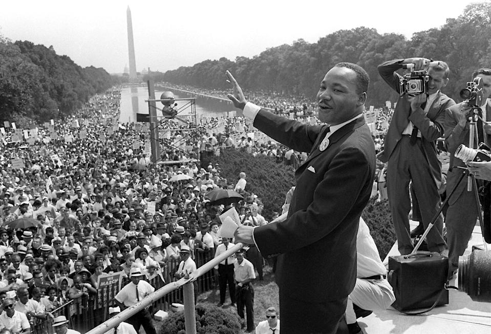 US civil rights leader Martin Luther King, Jr. waves to supporters from the steps of the Lincoln Memorial on August 28, 1963 in Washington, DC (AFP Photo/)