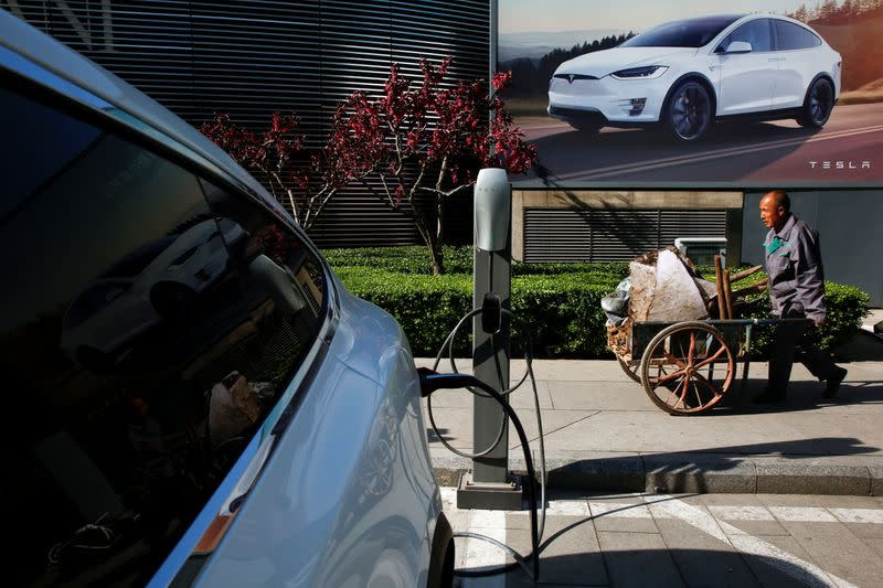 FILE PHOTO: A Tesla car being charged up at a charging station in Beijing