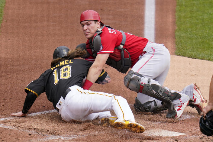 Cincinnati Reds catcher Tyler Stephenson tags out Pittsburgh Pirates' Ben Gamel (18) who was attempting to score from third on a fielder's choice by Michael Perez during the second inning of a baseball game in Pittsburgh, Thursday, Sept. 16, 2021. (AP Photo/Gene J. Puskar)