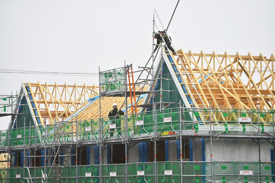Builders working on a housing estate