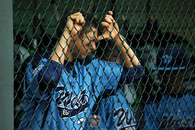 Las Vegas' Brennan Holligan reacts in the dugout during the last inning of the United States Championship baseball game against Chicago at the Little League World Series, Saturday, Aug. 23, 2014, in South Williamsport, Pa. Chicago won 7-5. (AP Photo/Matt Slocum)