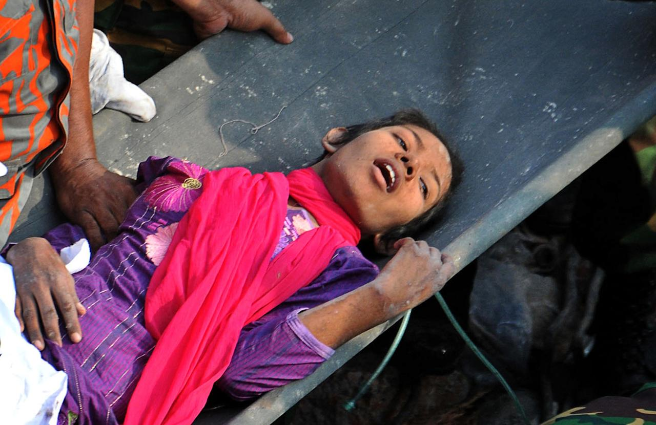 A survivor lies on a stretcher after being pulled out from the rubble of a building that collapsed in Savar, near Dhaka, Bangladesh, Friday, May 10, 2013. Rescue workers in Bangladesh freed the woman buried for 17 days inside the wreckage of a garment factory building that collapsed, killing more than 1,000 people. Soldiers at the site said her name was Reshma and described her as being in remarkably good shape despite her ordeal. (AP Photo)