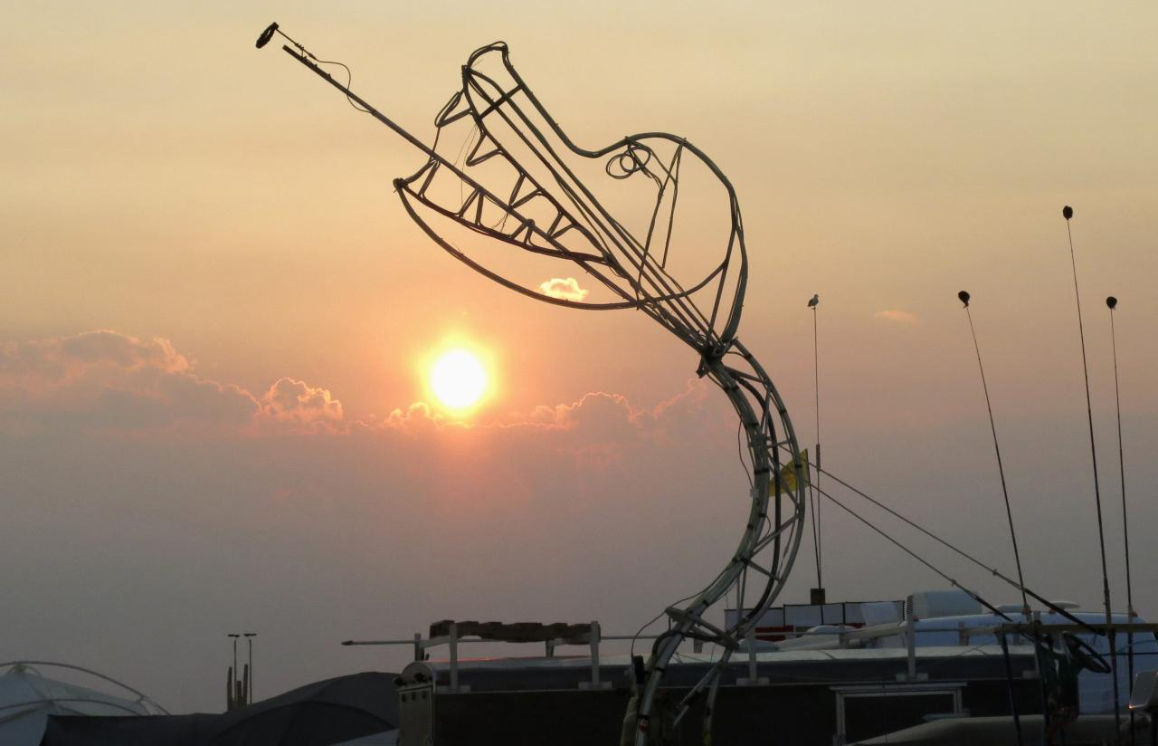 A sculpture of a fire breathing dragon is seen at sunrise during the 2013 Burning Man arts and music festival in the Black Rock Desert of Nevada, August 29, 2013. The federal government issued a permit for 68,000 people from all over the world to gather at the sold out festival, which is celebrating its 27th year, to spend a week in the remote desert cut off from much of the outside world to experience art, music and the unique community that develops. REUTERS/Jim Bourg (UNITED STATES - Tags: SOCIETY) FOR USE WITH BURNING MAN RELATED REPORTING ONLY. FOR EDITORIAL USE ONLY. NOT FOR SALE FOR MARKETING OR ADVERTISING CAMPAIGNS. NO THIRD PARTY SALES. NOT FOR USE BY REUTERS THIRD PARTY DISTRIBUTORS