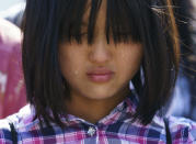<p>Tears run down the face of Naomi Liem, 10, of Franklin Park, N.J., on Capitol Hill in Washington, Tuesday, June 26, 2018, during a protest against immigrant families being split up. Liem's father, Guanuawan Liem, is currently being detained by ICE. (Photo: Carolyn Kaster/AP) </p>