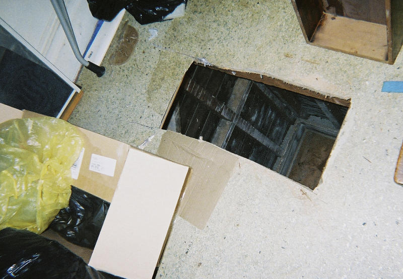 "This undated photo released by the San Francisco Office of the District Attorney show a hole cut into the floor of a San Francisco apartment. A couple prosecutors dubbed the ""landlords from hell"" for going to scary lengths to drive tenants from a San Francisco apartment building has pleaded guilty to several felonies. Prosecutors said Wednesday that 37-year-old Nicole Macy and 38-year-old Kip Macy threatened to shoot tenants, changed locks, cleared apartments of belongings, and sawed holes in floors, all in an attempt to drive renters out of their building in the increasingly pricey South of Market neighborhood. (AP Photo/San Francisco Office of the District Attorney)"