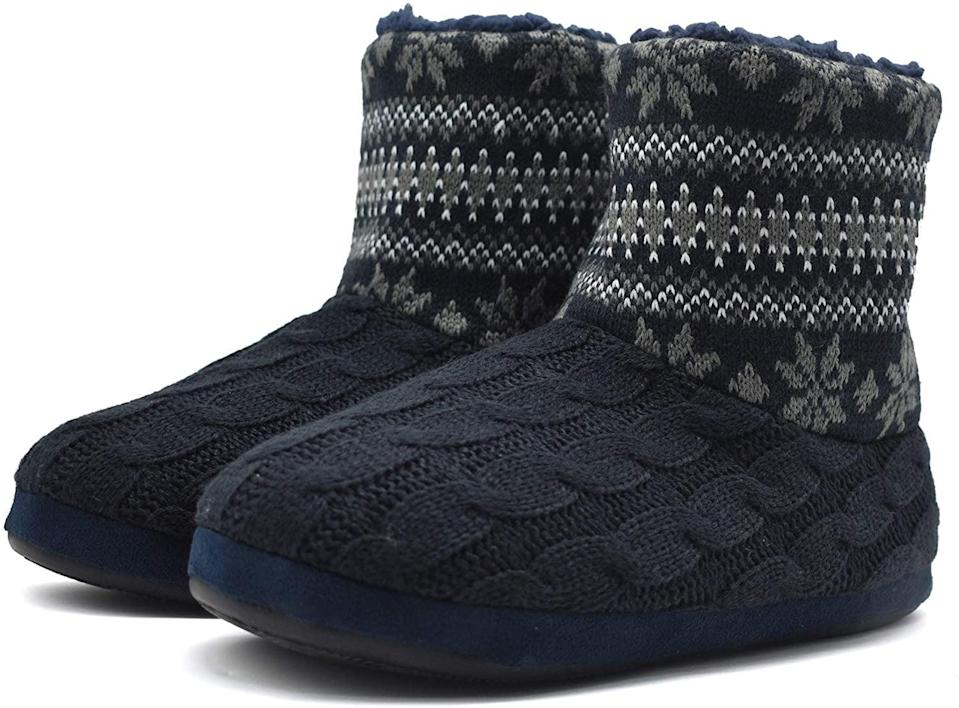 <p>Get them these ultra-soft <span>ONCAI Handmade Woolen Yarn Indoor Slipper Boots </span> ($28) for those cozy holiday vibes. They are sherpa lined and come in a variety of patterns and colors.</p>