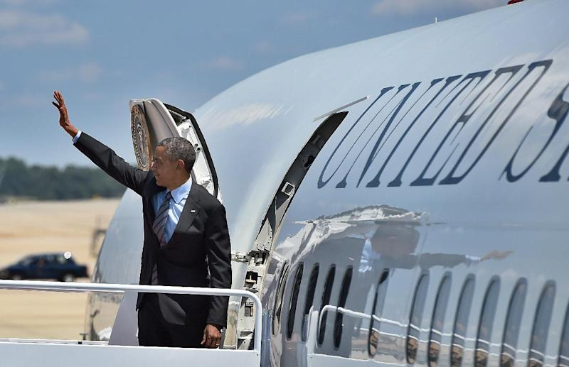 US President Barack Obama boards Air Force One at Andrews Air Force Base in Maryland on July 17, 2014 (AFP Photo/Jewel Samad)