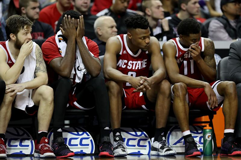 CHARLOTTE, NORTH CAROLINA - MARCH 14: Teammates Torin Dorn #2 and Markell Johnson #11 of the North Carolina State Wolfpack react to their 76-56 loss against the Virginia Cavaliers in the quarterfinal round of the 2019 Men's ACC Basketball Tournament at Spectrum Center on March 14, 2019 in Charlotte, North Carolina. (Photo by Streeter Lecka/Getty Images)