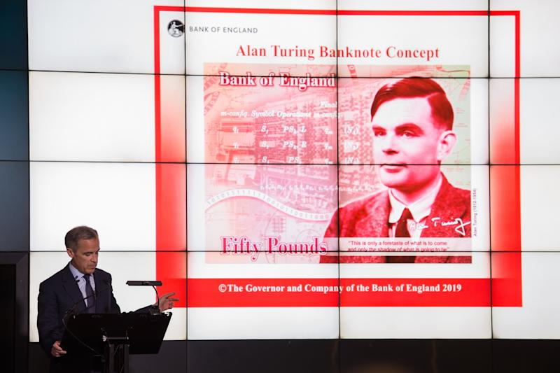 Mark Carney, governor of the Bank of England, speaks in front of the concept design for the new Bank of England fifty pound banknote, featuring mathematician and scientist Alan Turing, during the presentation at the Science and Industry Museum in Manchester, north-west England on July 15, 2019.