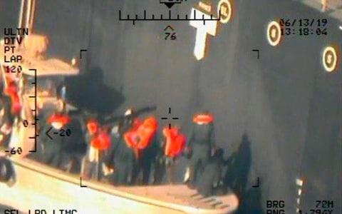 This photo shows what the Navy says are members of the Islamic Revolutionary Guard Corps Navy removing an unexploded limpet mine from the M/T Kokuka Courageous - Credit: AP