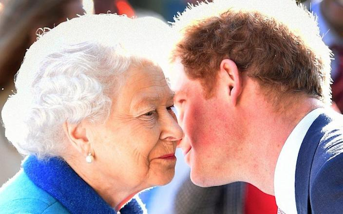 Prince Harry kisses his grandmother in a photograph taken in 2015 - JULIAN SIMMONDS