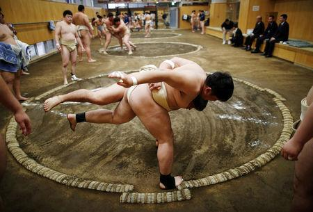 College students work out at the Sumo wrestling club at Nippon Sports Science University in Tokyo, Japan May 20, 2019. REUTERS/Issei Kato