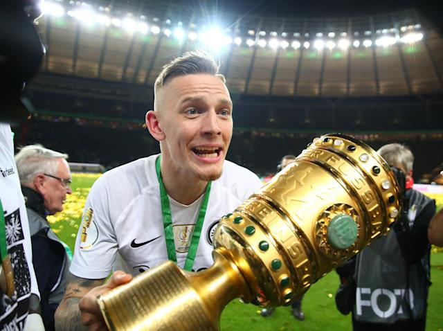 Soccer Football - DFB Cup Final - Bayern Munich vs Eintracht Frankfurt - Olympiastadion, Berlin, Germany - May 19, 2018 Eintracht Frankfurt's Marius Wolf celebrates with the trophy after winning the DFB Cup REUTERS/Michael Dalder DFB RULES PROHIBIT USE IN MMS SERVICES VIA HANDHELD DEVICES UNTIL TWO HOURS AFTER A MATCH AND ANY USAGE ON INTERNET OR ONLINE MEDIA SIMULATING VIDEO FOOTAGE DURING THE MATCH.