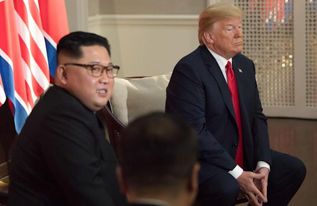 <p>North Korea's leader Kim Jong Un (L) sits down with US President Donald Trump (R) their historic US-North Korea summit, at the Capella Hotel on Sentosa island in Singapore on June 12, 2018. – Donald Trump and Kim Jong Un became on June 12 the first sitting US and North Korean leaders to meet, shake hands and negotiate to end a decades-old nuclear stand-off. (Photo: Saul Loeb/AFP/Getty Images) </p>