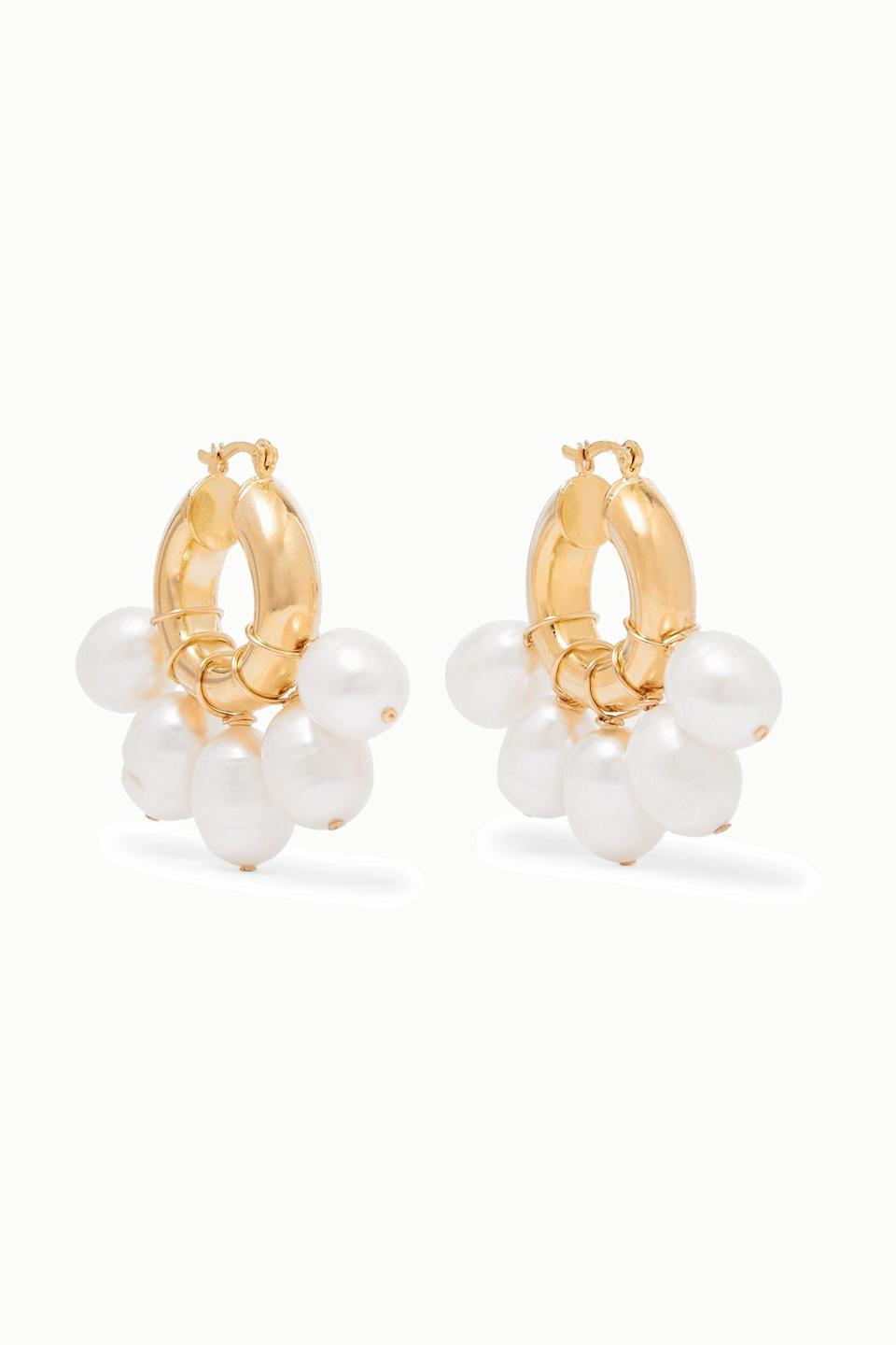 """<p><strong>éliou</strong></p><p>net-a-porter.com</p><p><strong>$96.00</strong></p><p><a href=""""https://go.redirectingat.com?id=74968X1596630&url=https%3A%2F%2Fwww.net-a-porter.com%2Fen-us%2Fshop%2Fproduct%2Feliou%2Fkavala-gold-plated-pearl-earrings%2F1147745&sref=https%3A%2F%2Fwww.redbookmag.com%2Ffashion%2Fg34824874%2Fbest-jewelry-gift-ideas%2F"""" rel=""""nofollow noopener"""" target=""""_blank"""" data-ylk=""""slk:Shop Now"""" class=""""link rapid-noclick-resp"""">Shop Now</a></p><p>These pearl earrings are the best of everything: hoops <em>and </em>pearls in one, beautiful package. </p>"""