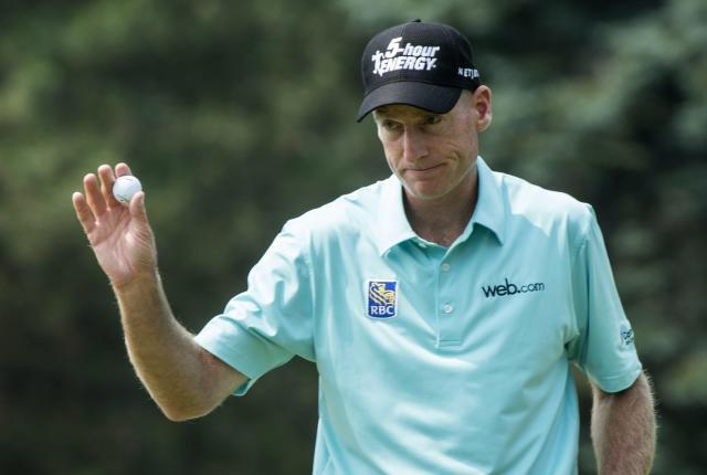 Jim Furyk salutes the crowd after putting out on the 9th hole during second round play at the Canadian Open golf championship Friday, July 25, 2014 in Montreal. (AP Photo/The Canadian Press, Paul Chiasson)