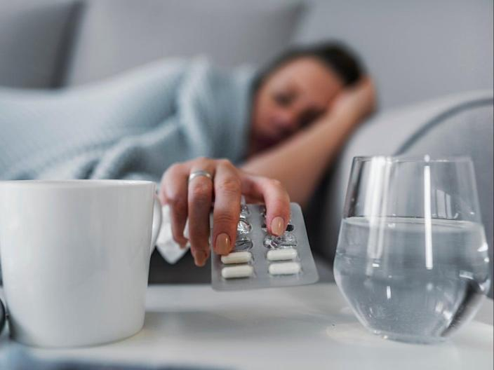 People should avoid taking painkillers after receiving a Covid vaccine, experts have said (Getty Images)