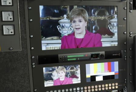 Scotland's First Minister Nicola Sturgeon is seen on screens in a television production truck as she demands a new independence referendum to be held in late 2018 or early 2019, outside Bute House, in Edinburgh