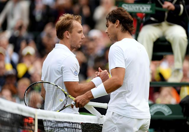 LONDON, ENGLAND - JUNE 24: Steve Darcis of Belgium shakes hands at the net with Rafael Nadal of Spain after their Gentlemen's Singles first round match on day one of the Wimbledon Lawn Tennis Championships at the All England Lawn Tennis and Croquet Club on June 24, 2013 in London, England. (Photo by Mike Hewitt/Getty Images)