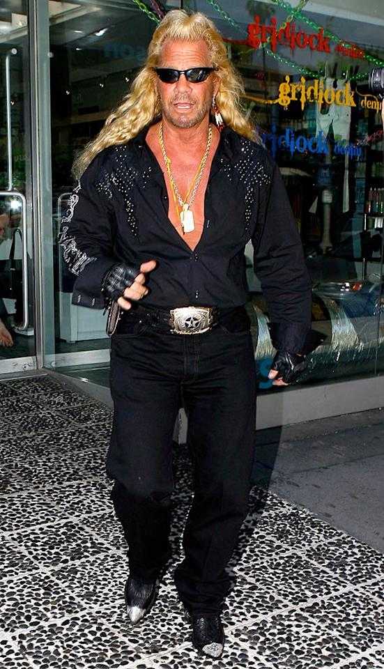 """We don't expect Duane """"Dog the Bounty Hunter"""" Chapman to ever stop sporting bedazzled tops and steel-toed boots, but that overly processed mane of his has got to go! <a href=""""http://www.x17online.com"""" target=""""new"""">X17 Online</a> - April 29, 2009"""
