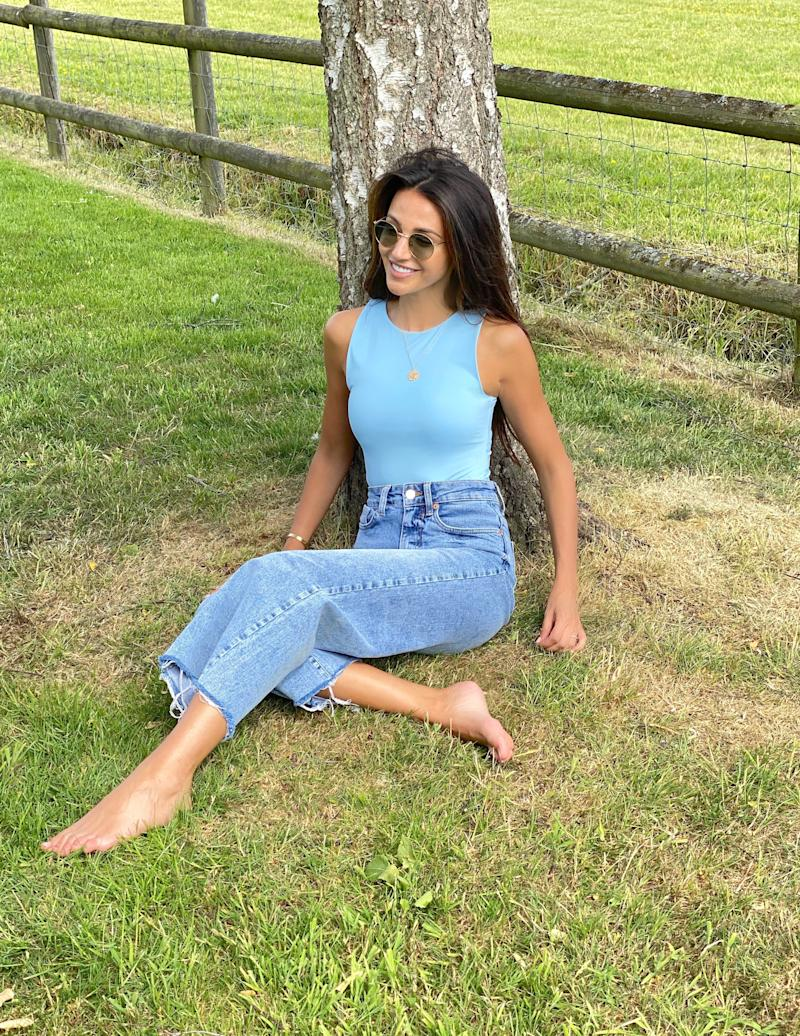 The Our Girl actor perches up against a tree in a pastel blue bodysuit from her new range. (Very)