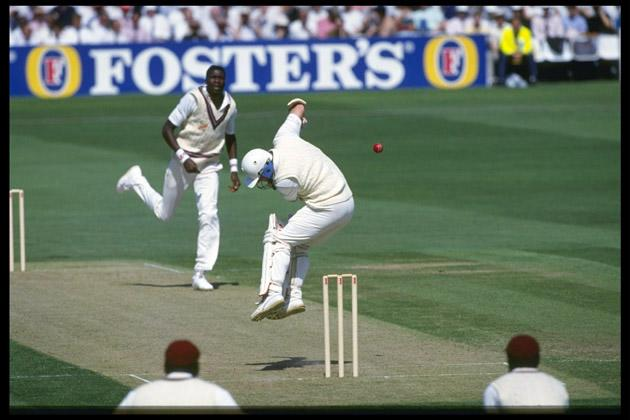 Aug 1991:  Hugh Morris of England avoids a bouncer from Curtly Ambrose of the West Indies during the 5th Test at The Oval Mandatory Credit: Adrian Murrell/Allsport UK