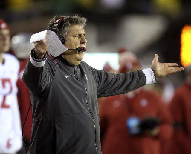 Washington State head football coach Mike Leach gestures to his team after a penalty call during the second quarter of an NCAA college football game against Oregon, Saturday, Oct. 26, 2019, in Eugene, Ore. (AP Photo/Chris Pietsch)