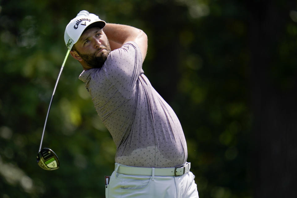 Jon Rahm, of Spain, tees off from the fifth hole during the third round of the BMW Championship golf tournament, Saturday, Aug. 28, 2021, at Caves Valley Golf Club in Owings Mills, Md. (AP Photo/Julio Cortez)