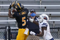UTSA cornerback Ken Robinson, right, breaks up a pass to Southern Mississippi wide receiver Tim Jones (5) during the second half of an NCAA college football game, Saturday, Nov. 21, 2020, in Hattiesburg, Miss. UTSA won 23-20. (AP Photo/Rogelio V. Solis)