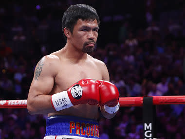 Manny Pacquiao's trainer Freddie Roach mulls on Filipino boxer's retirement, admits rematch against Floyd Mayweather unlikely