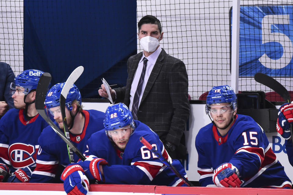 MONTREAL, QC - MARCH 04:  Assistant coach of the Montreal Canadiens Alex Burrows looks on from behind the bench against the Winnipeg Jets during the first period at the Bell Centre on March 4, 2021 in Montreal, Canada.  The Winnipeg Jets defeated the Montreal Canadiens 4-3 in overtime.  (Photo by Minas Panagiotakis/Getty Images)