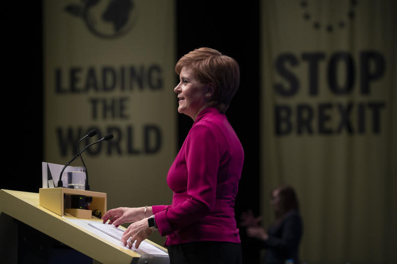 First Minister of Scotland Nicola Sturgeon delivers her keynote speech to delegates during the Scottish National Party (SNP) autumn conference in Aberdeen, Scotland, Tuesday Oct. 15, 2019. The SNP is a major regional force in the Brexit debate throughout the United Kingdom. (Jane Barlow/PA via AP)