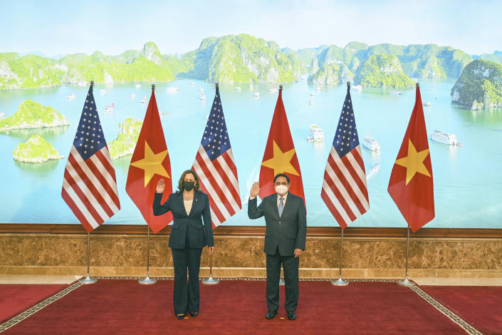 U.S. Vice President Kamala Harris, left, and Vietnamese Prime Minister Pham Minh Chinh pose for a photo at the government office in Hanoi, Vietnam, Wednesday, Aug. 25, 2021. Harris turns her focus to the coronavirus pandemic and global health during her visit to Vietnam, a country grappling with a worsening surge in the virus and stubbornly low vaccination rates. (Manan Vatsyayana/Pool Photo via AP)