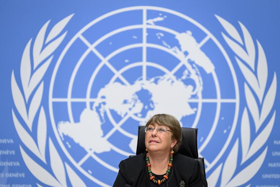 "UN High Commissioner for Human Rights Michelle Bachelet looks on prior to a press conference on December 9, 2020 in Geneva. - The UN human rights chief warned that the coronavirus crisis had ""zeroed in on the fissures and fragilities in our societies,"" including a failure to respect basic rights. (Photo by Fabrice COFFRINI / AFP) (Photo by FABRICE COFFRINI/AFP via Getty Images)"