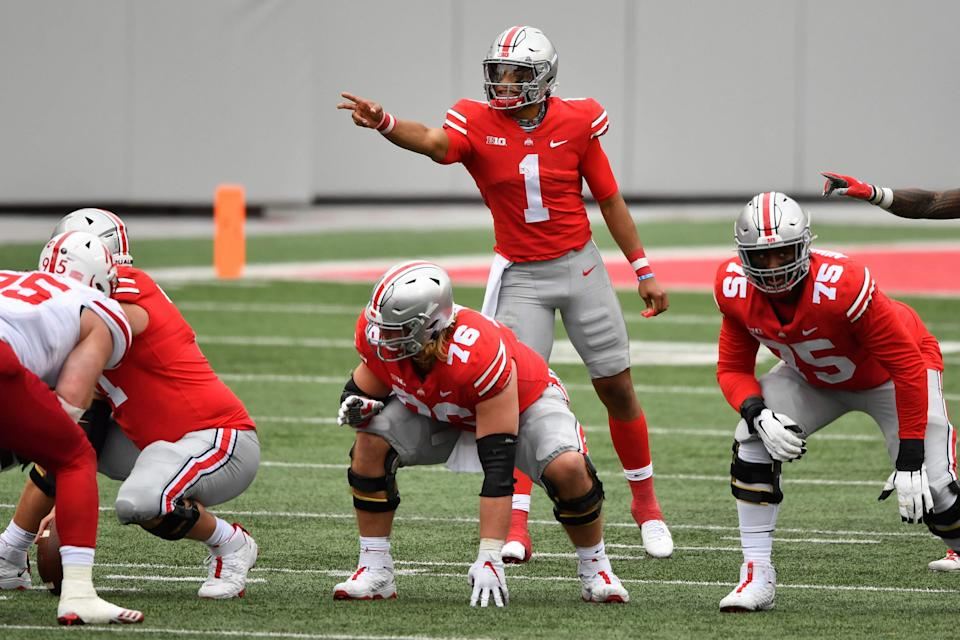 Quarterback Justin Fields of the Ohio State Buckeyes calls signals at the line against the Nebraska Cornhuskers at Ohio Stadium on Oct. 24, 2020 in Columbus, Ohio. (Jamie Sabau/Getty Images)