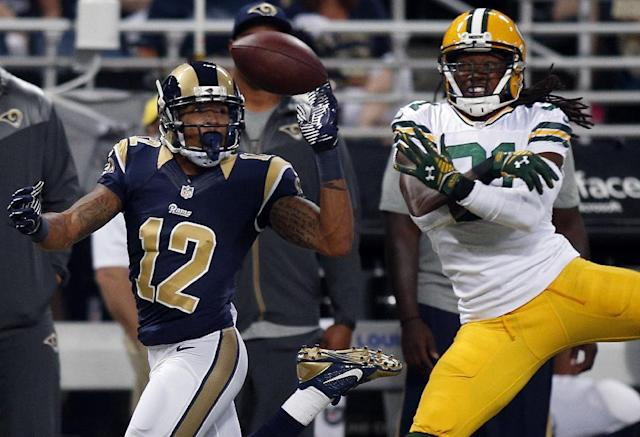 Green Bay Packers cornerback Davon House, right, breaks up a pass intended for St. Louis Rams wide receiver Stedman Bailey during the second quarter of an NFL preseason football game Saturday, Aug. 16, 2014, in St. Louis. (AP Photo/Scott Kane)