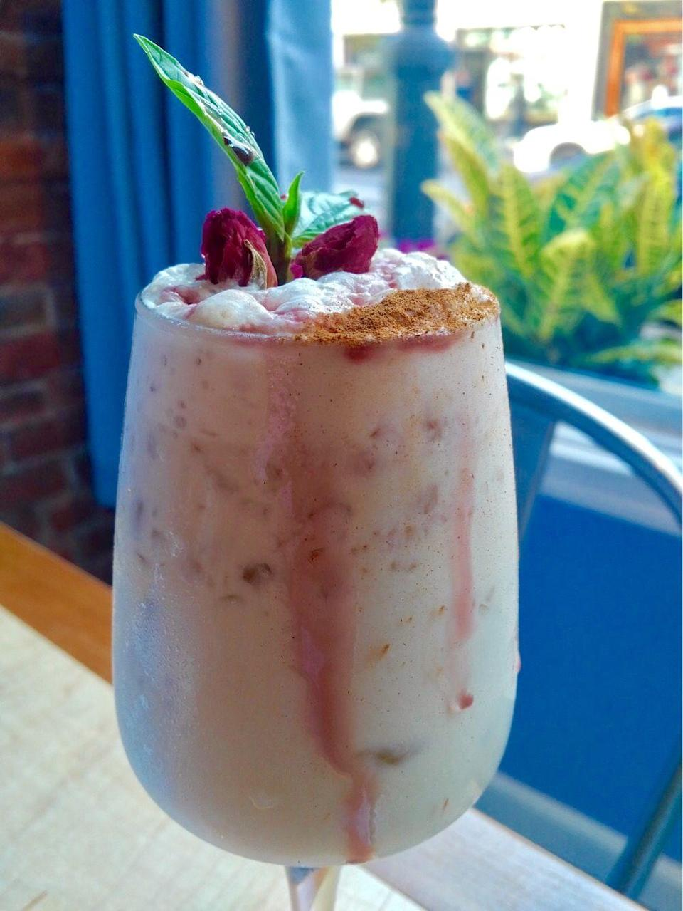 """<p><strong>Ingredients</strong><br>1.5 oz Bailey's<br>1 oz Woodford Reserve Bourbon<br>1 oz eggnog<br>1 egg white<br>Nutmeg and cinnamon to garnish<br>Grenadine (optional)<br>Crushed ice</p><p><strong>Instructions</strong><br>Combine all ingredients and shake vigorously with crushed ice. Pour into large wine glass. Drizzle with raspberry coulis or grenadine. Garnish with grated nutmeg and cinnamon and miniature rose buds. </p><p><em>From <a href=""""http://auntjakesnyc.com/"""" rel=""""nofollow noopener"""" target=""""_blank"""" data-ylk=""""slk:Aunt Jake's"""" class=""""link rapid-noclick-resp"""">Aunt Jake's</a>, New York City</em></p>"""