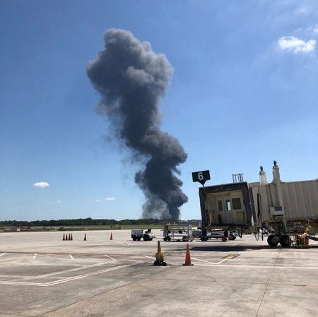 Smoke rises from an airplane crash near Savannah airport, Georgia, U.S., May 2, 2018 in this picture obtained from social media. TWITTER/@CHEYENNEJANIECE/via REUTERS