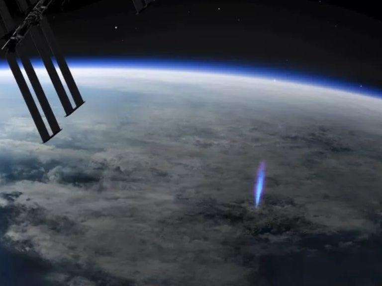 <p>An artist's visualisation of the blue jet lighting and pulses observed from the International Space Station</p> (ESA)