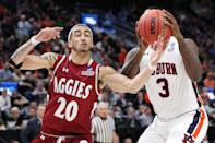 <p>Trevelin Queen #20 of the New Mexico State Aggies battles for the ball with Danjel Purifoy #3 of the Auburn Tigers during the first half in the first round of the 2019 NCAA Men's Basketball Tournament at Vivint Smart Home Arena on March 21, 2019 in Salt Lake City, Utah. (Photo by Patrick Smith/Getty Images) </p>