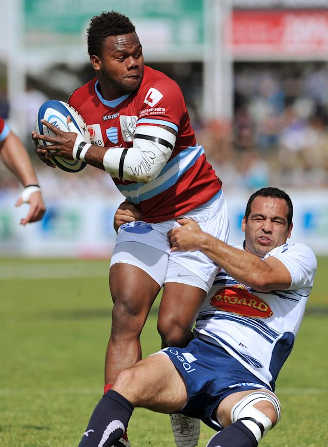 Agen's fly-half Conrad Barnard (R) tackles Metro Racing's centre Virimi Vakatawa (L) during the French Top 14 rugby Union match Agen vs Racing on May 12, 2012 in the French southern city of Agen. AFP PHOTO/PIERRE ANDRIEUPIERRE ANDRIEU/AFP/GettyImages