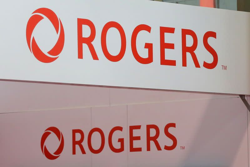 Rogers Communications logos are seen above a booth at the Canadian International AutoShow in Toronto