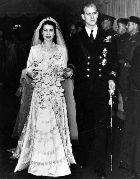 PHOTO: Queen Elizabeth II, as Princess Elizabeth, and her husband the Duke of Edinburgh, styled Prince Philip in 1957, on their wedding day. She became queen on her father King George VI's death in 1952. (Hulton Archive/Getty Images)