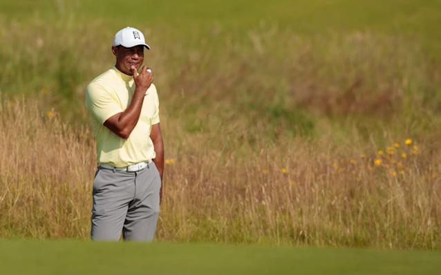 Tiger Woods looking ponderous during an unimpressive spot of practise at Portrush - AP