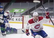 Montreal Canadiens' Jonathan Drouin celebrates his goal against Vancouver Canucks goalie Braden Holtby during the third period of an NHL hockey game Saturday, Jan. 23, 2021, Vancouver, British Columbia. (Darryl Dyck/The Canadian Press via AP)